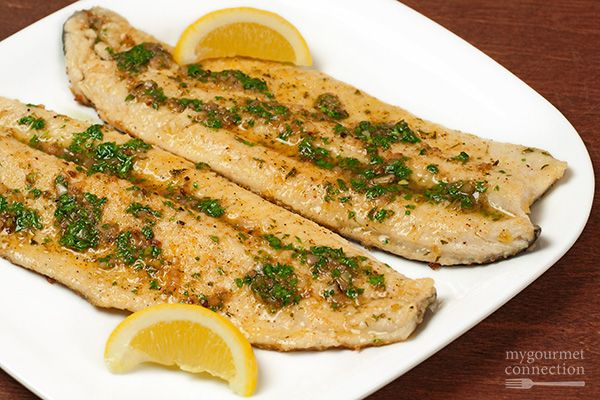 Rainbow trout fillets lightly dredged in seasoned flour, sautéed in butter, then topped with meunière sauce, a simple brown butter sauce with lemon juice and fresh parsley.