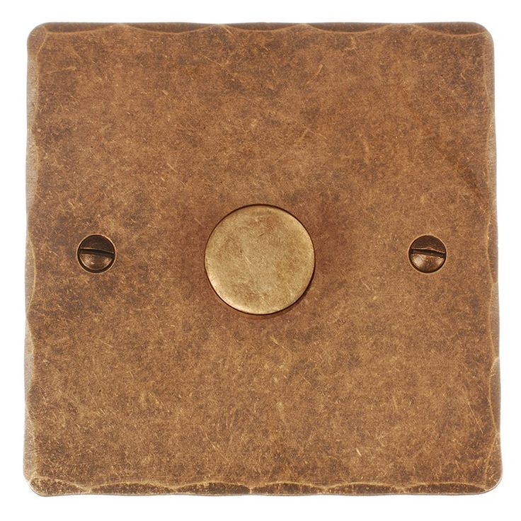This touch dimmer with antiqued brass hammered plate is a modern classic