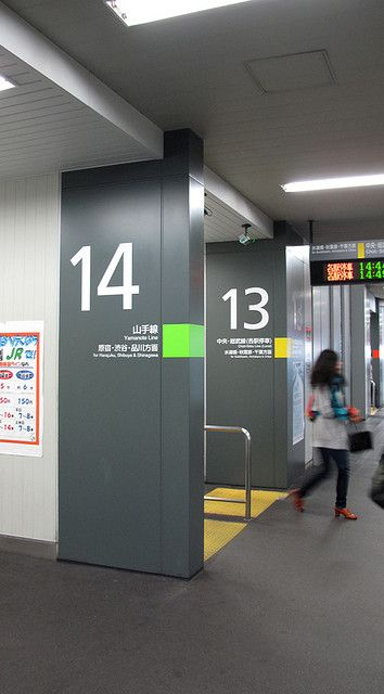 like large numbers on wall. Put a vertical strip of color next to doors and then in white type sticky letters but a large 1 for room 1 and then Training Room, etc. #Signalétique