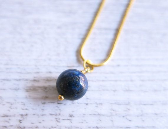 This beautiful necklace is made from a stunning sphere of lapis lazuli suspended from a 24k gold plated chain.  Lapis Lazuli is thought to