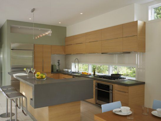 Detail view of the kitchen featuring GE and Kitchen Aid appliances, Caesar Stone countertops, and af