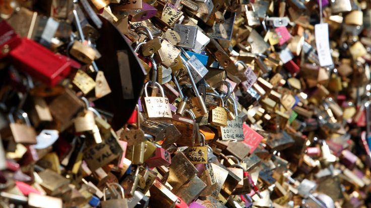 love lock bridge collapse. local hates the idea of tourist defacing their bridges.