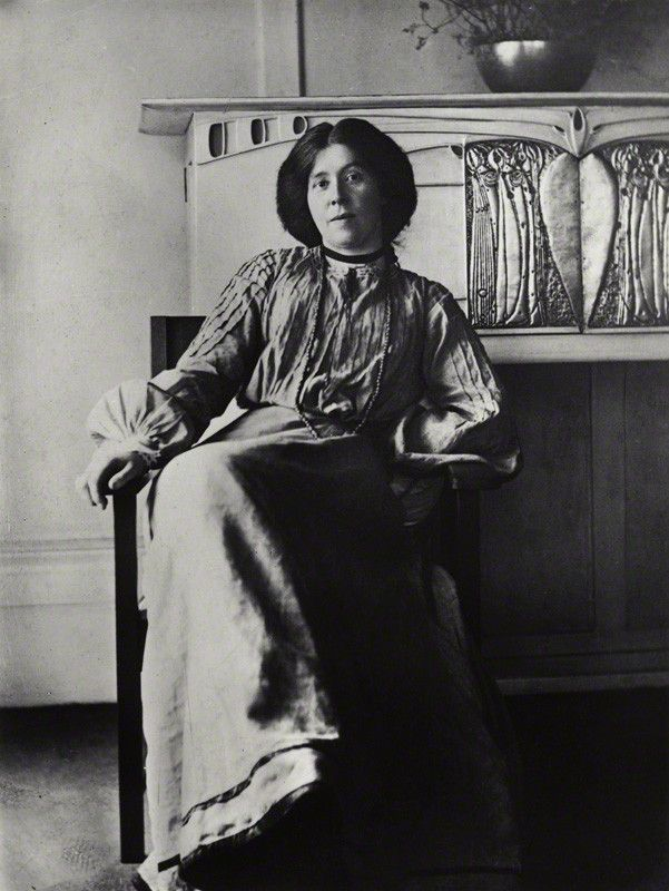 Margaret Macdonald Mackintosh (1865-1933) - Circa 1901, Sitting in front of one of her designs.