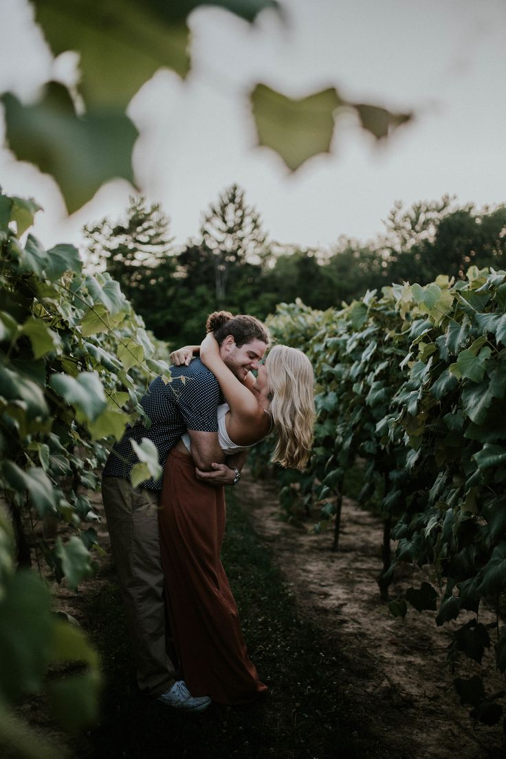 Vineyards and wineries make great locations for fall engagement photos! For more engagement and wedding photo setting, outfit, and pose ideas, visit my website here!