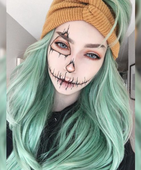 Metallic green hair color perfect for halloween! and that makeup too <3