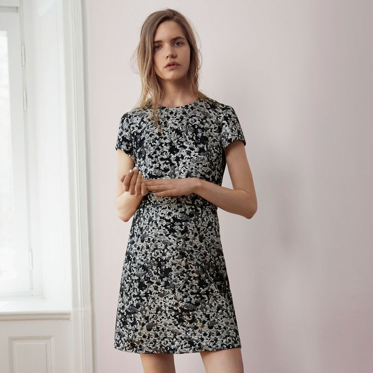 FWSS Into The Fog is a cocktail dress in silver spotted jacquard with an empire waist and jersey backing.