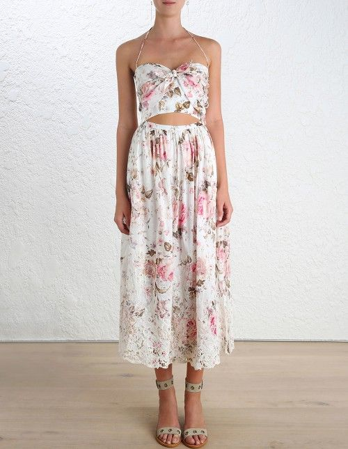 Eden Embroidered Tie Dress, from our Summer Swim 16 collection, in Floral printed textured cotton. Floral embroidered detail through skirt. Cutout detail at waist, tie detail bodice and gathered skirt. Shoestring halter neck tie with tassels. Centre back zip closure.