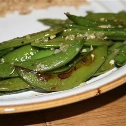 Shallots and a little thyme are sprinkled over irresistible sugar snap peas!
