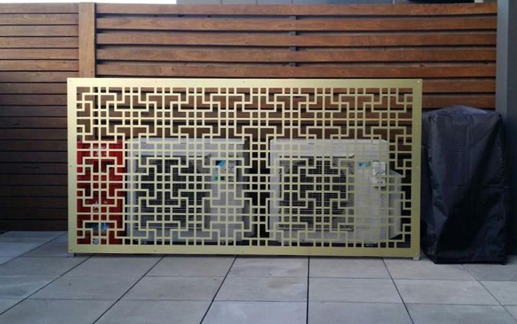QAQ's 'Tokyo' decorative screen design in gold-brushed ACM used to cover two ugly patio units.
