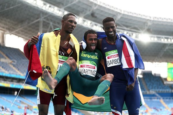 (L-R) Luis Arturo Paiva of Venezuela, Daniel Martins of Brazil and Gracelino Barbosa of Cape Verde celebrate after the Men's 400m - T20 Final at the Olympic Stadium on Day 2 of the Rio 2016 Paralympic Games on September 9, 2016 in Rio de Janeiro, Brazil.