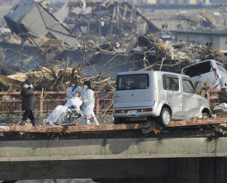 A patient is evacuated from a destroyed hospital in Otsuchi, Iwate Prefecture, on March 13, 2011.