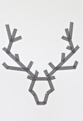 Masking tape deer head - could do this on canvas, paint over it and pull off tape