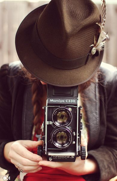 I would LOVE to have a vintage camera, and learn to develope. Talk about authentic photographs!!
