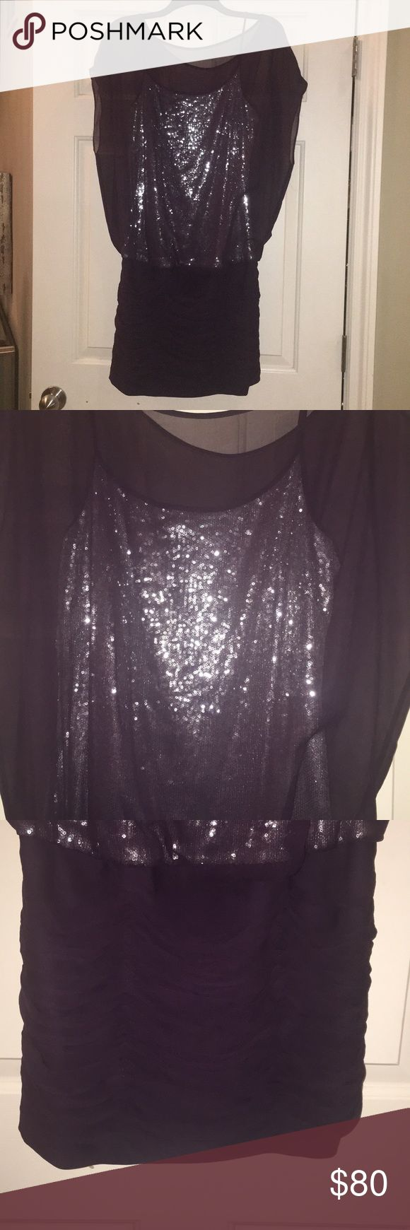 Beautiful plum with silver sequin cocktail dress. Sexy yet flattering around the mid section. Chiffon over silver sequin spaghetti strap styled top with chiffon rouched skirt. Chiffon top and tank are connected to the rouched bottom. Flowy on top and more fitted in the skirt. Covers upper arms and midsection without being frumpy. Only worn once. In excellent condition. Adrianna Papell Dresses Mini