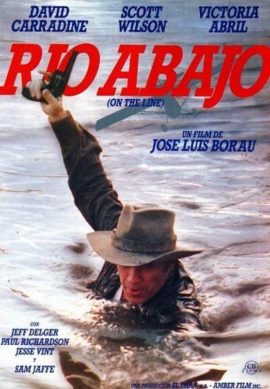 DVD CINE 2466 - Río abajo (1984) EEUU. Dir.: José Luis Borau. Drogas. Migración. Sinopse: un axente fronteirizo está decidido a deter a un delincuente norteamericano que pasa material de contrabando a ilegais a través da fronteira de México,  unha terra de ninguén poblada de prostitutas, borrachos e contrabandistas