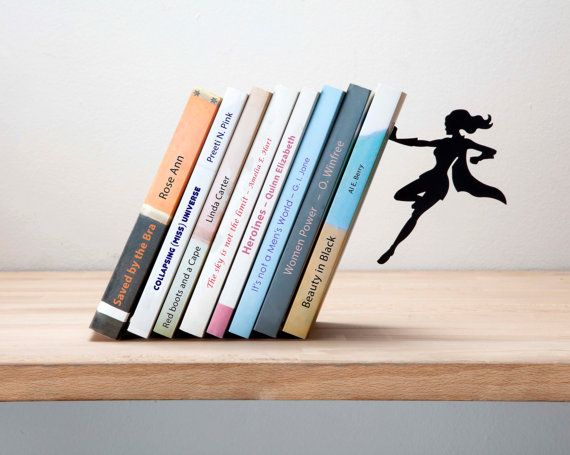 Continuing product to our worldwide best seller Falling bookend.  Books lean on it at a special angle, giving a feeling that they are about to collapse. Then the superhero character seems to stop them preventing them from falling.  Place the bookend wall between the book cover and the first/last page of the book.Use a soft covered book (paperback). Lean other books on it. Make sure the books cover at least the whole length of the bookend base. Attach the superheros magnetic hand to the s...
