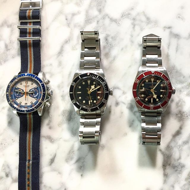 REPOST!!!  What a view! 3 iconic pieces . . #rolex #tudor #blackbay #blackbayblack #heritagechrono #heritagechronoblue #chronograph #natostrap #steel #diver #divewatch #sportwatch #timepiece #watches #watchporn @dailywatch @luxurylifestylemagazine  Photo Credit: Instagram ID @hunginator
