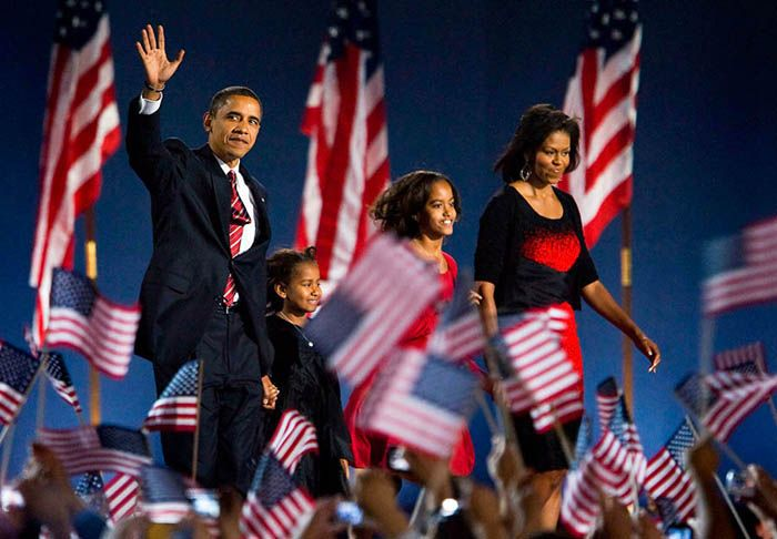Election 2008: Barack Obama's Election Night – Grant Park  Tuesday, November 4th 2008.  Barack Obama waves on stage with wife Michelle and daughters Malia and Sasha as he walks to give his victory speech at Grant Park after becoming the country's first black president.