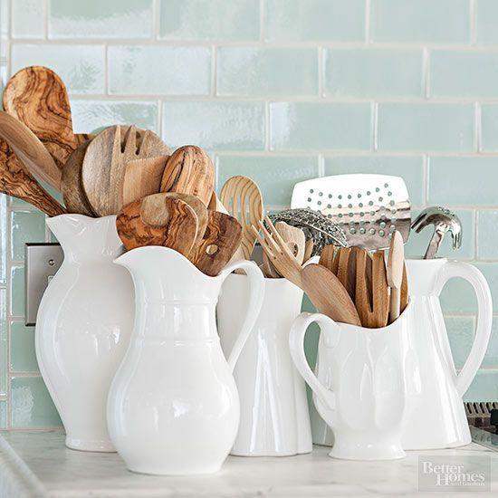 Repurpose a bounty of pitchers as handy countertop utensil storage.