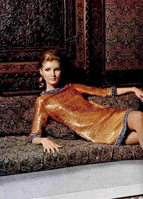 Pierre Cardin Flashback - An Outtake Pat McGuire is wearing a simple shift in sparkling gold lame trimmed in sapphire blue beadwork by Pierre Cardin, photo by Roland Bianchini, 1967