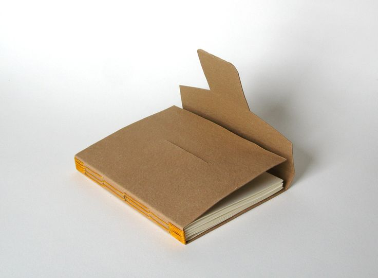 Small notebook with long stitch binding and a tabbed closure.