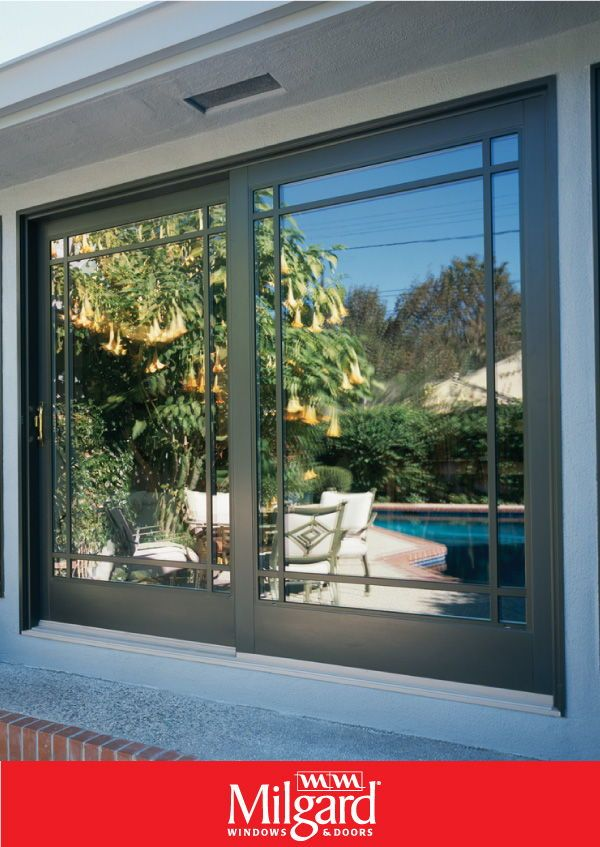 Perimeter Grids On Sliding Doors Add A Decorative Touch It S A Modern Twist To The Classic French Door Whether French Doors Patio House Exterior Patio Doors