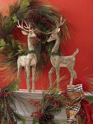 I love the wreath behind the reindeer!pretty Christmas display for the mantel
