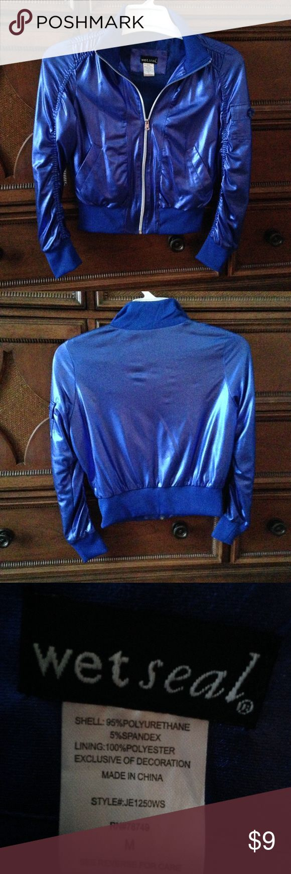 Electric Blue Metallic Zip Up Jacket SWEET statement jacket. Very soft silky feeling and oh that shine!!!!! Cinched seams, left pocket on the upper sleeve and front pockets add extra flair.  Brand is Wet Seal. Shell is 95% polyurethane 5% spandex and lining is 100% polyester. Size is medium but it can still look nice on a size small, too. All prices negotiable-and great bundle options just ask. Make an offer! Wet Seal Jackets & Coats