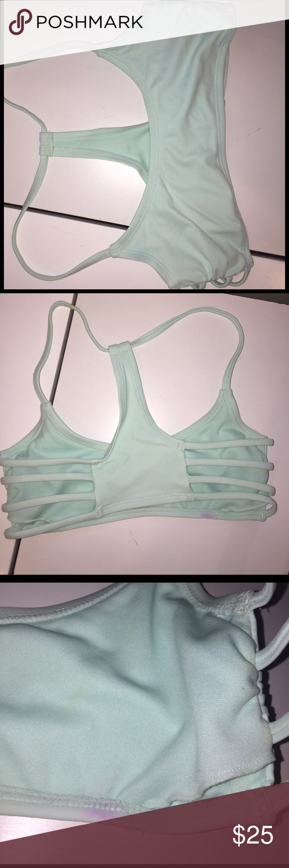 Mint bikini XS Mint bikini from target. Has an insert for pads however does not have any in right now. In good condition, worn a couple of times last summer but now it is too small! Swim Bikinis