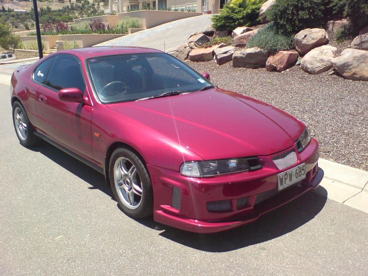 My first car 94 Prelude excuse the black widow front bar I was young