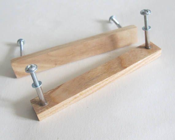 These handmade wooden drawer pulls are made from an oak wood. The set of 2 drawer pulls is a great addition to the rustic furniture. Each handle has a screw for attaching. SIZE: Long- 14 cm (5.5), height- 3 cm (1.2), width 1.8 cm 11 cm(4.3) apart from center of screw All items are an