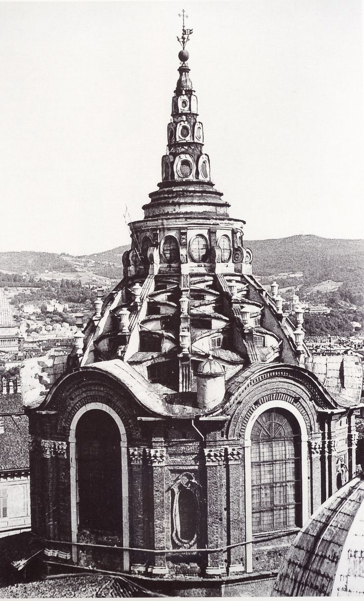 "ITALIAN BAROQUE ARCHITECTURE, Piedmont; Cappella della SS. Sindone, 1667-90, Turin Cathedral, by Guarini. ""Exterior the ribs over the segmental windows of the Cappella are like the zig-zag steps of a Ziggurat or tower of Babel, while the surmounting lantern also diminished in three stages like a pagoda or a Buddhist stupa."""