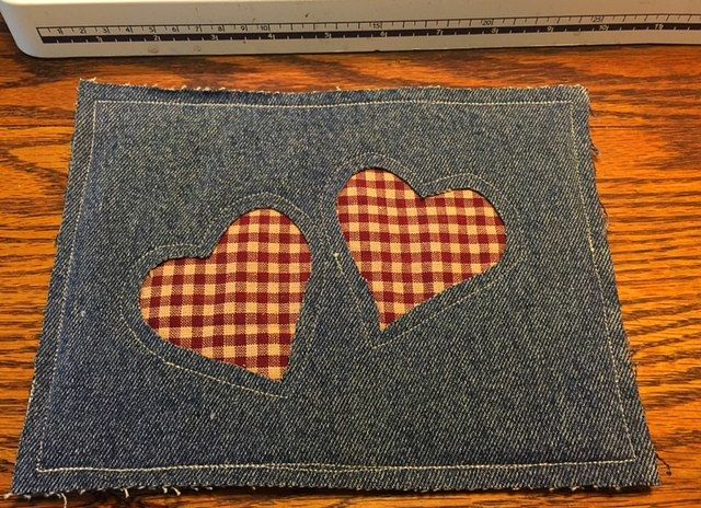 Here's an easy reverse applique upcycled denim potholder made from old jeans.  This pot holder takes about 20 minutes to make.