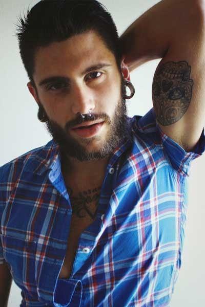 beard. septum piercing. tattoos.