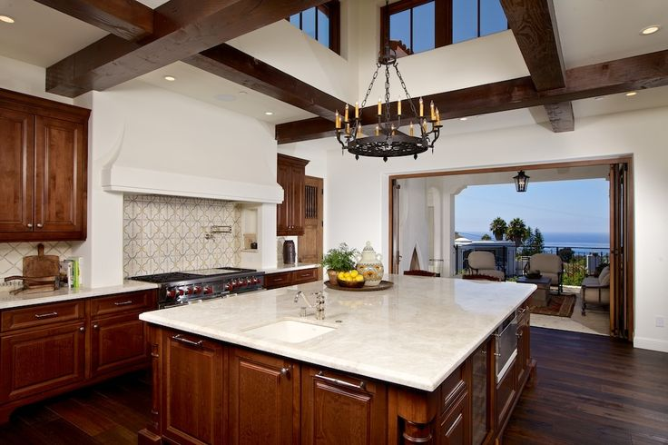 Mediterranean Kitchen with Limestone Tile, High ceiling, Chandelier, Complex marble counters, Breakfast bar, Flush, One-wall