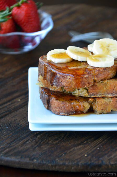 Banana Bread French Toast recipe | Transform everyone's favorite quickbread into the ultimate banana bread French toast topped with sliced bananas and maple syrup. | justataste.com #recipe #bananabread