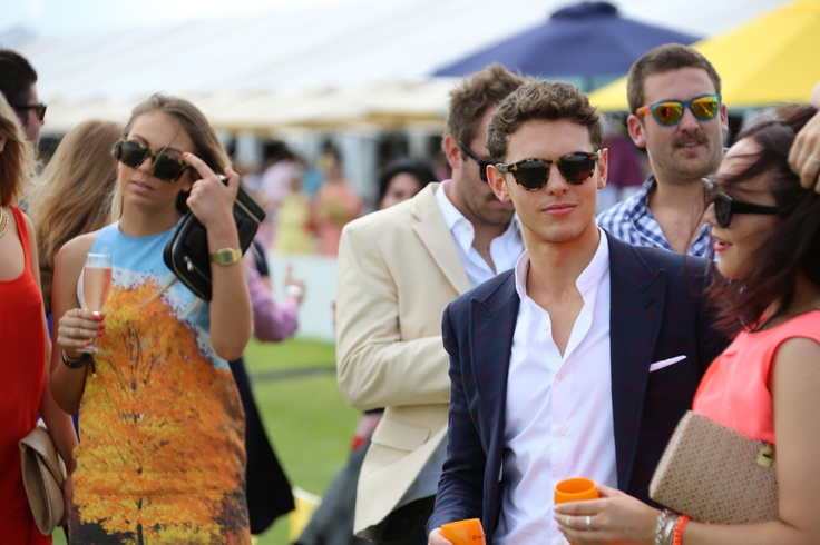 Tom O'Connor and Elyse Goyen soaking up the Paspaley Polo in the City at Doomben