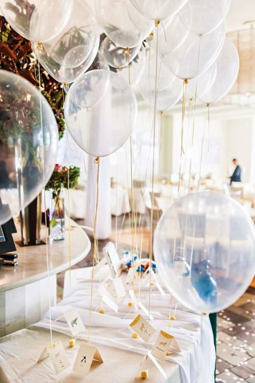 Clear balloons, I could fill them with glitter or confetti