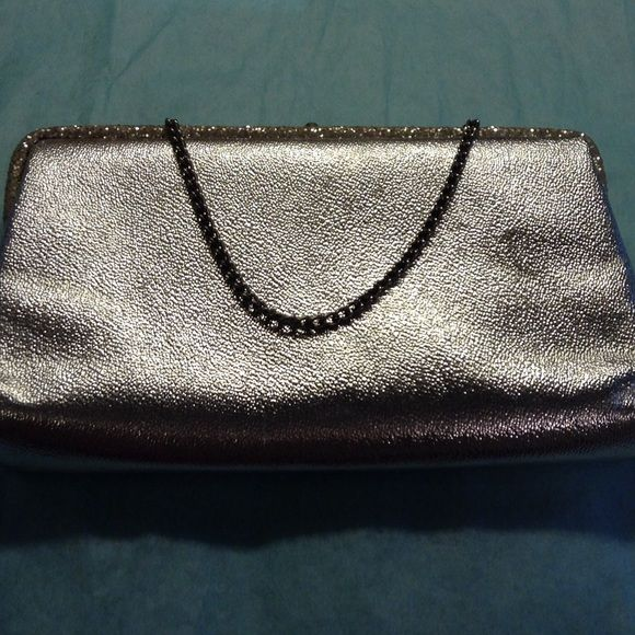 Silver clutch bag (vintage) It is silver with silver glitter on the top. Can be used with or without the chain strap. Accessories
