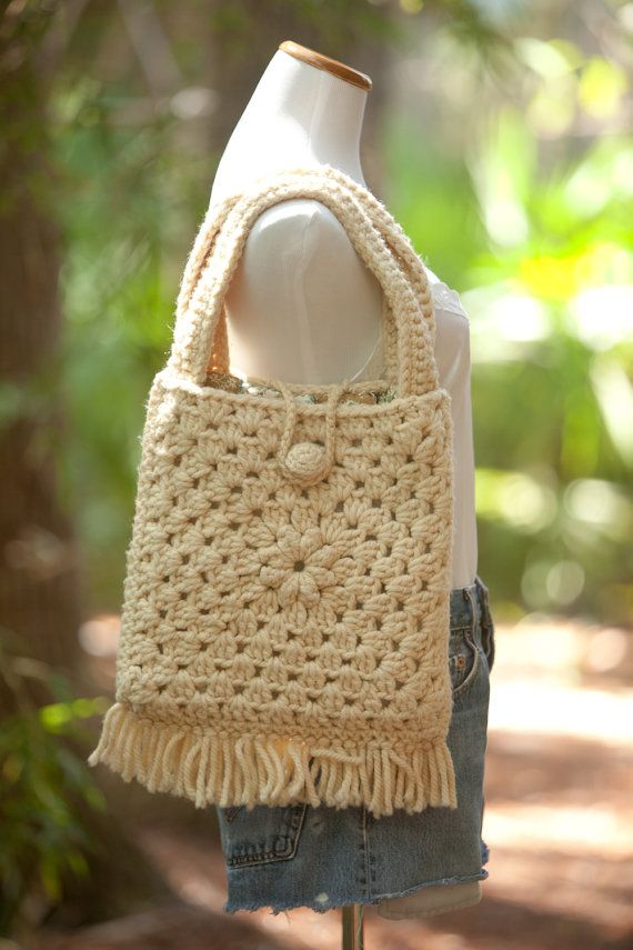 Nice crochet granny square purse / bag. Ivory / cream color with a button and loop closure. Lined with quilt like material. Slight pilling