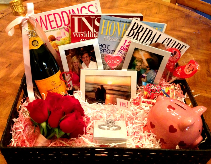 Perfect Engagement Gift Basket! :) Wedding magazines, champagne, piggy bank for wedding savings, pictures of the couple, red roses, ring pop, etc...