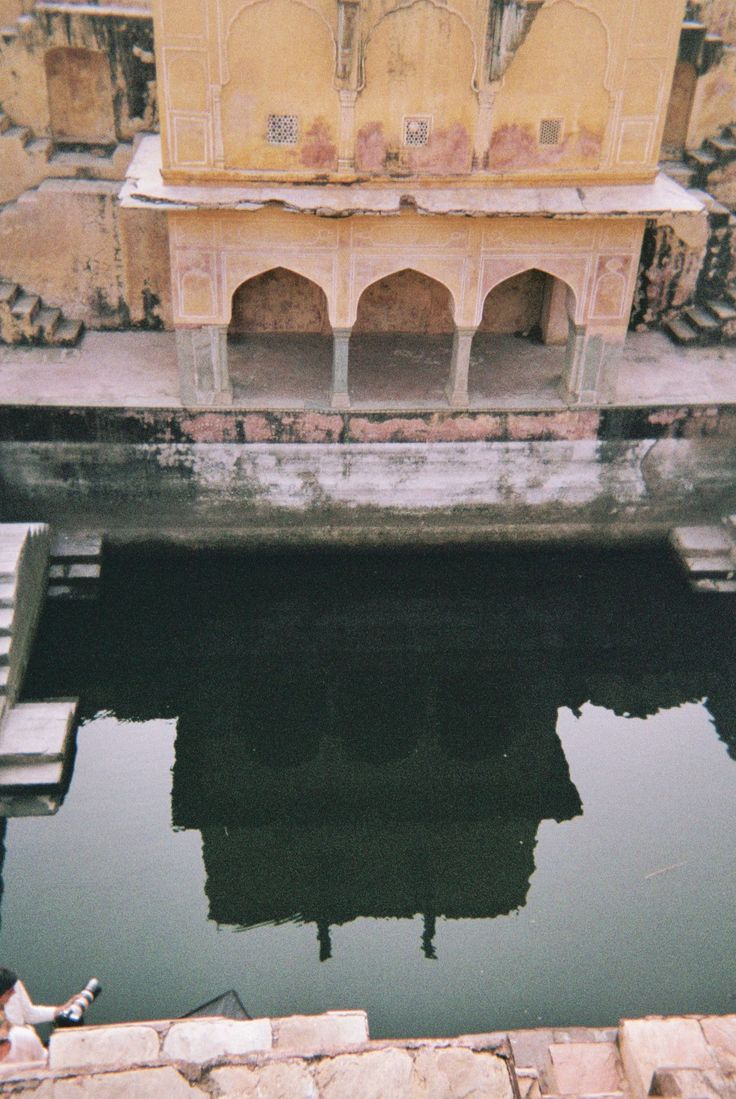 A deserted step well on the road to the Amer Fort in Jaipur (India). One of the most beautiful places I've ever seen in my life.