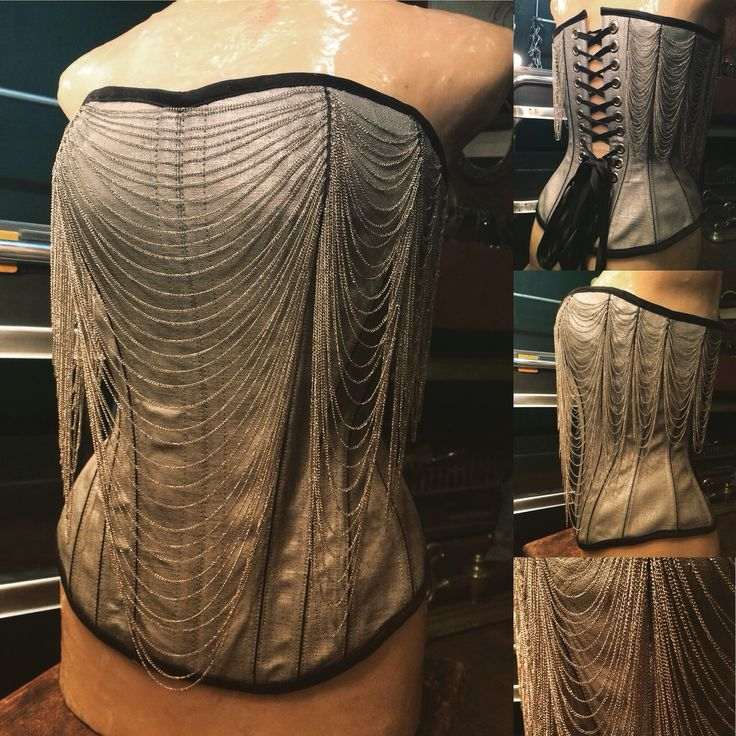 Metallic silver corset with draped chain detail by Arwen Garmentry