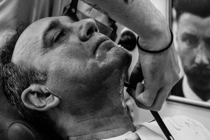 """The man with the """"Mo"""" watches your every move.... Make your appointments for a straight razor shaving experience at Rooster's Barbershop Athens . Ο άνθρωπος με το μουστάκι παρακολουθεί την κάθε σου κίνηση... Κλείστε το ραντεβού σας για να ζήσετε την εμπειρία ενός παραδοσιακού ξυρίσματος με φαλτσετα στο  Rooster's Barbershop Athens  #roostersBarbershop #roosters #roostersbarbershopathens #barbershopathens #straightrazorshave #shavingexperience"""