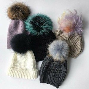 H.E. Rossi Winter Hat with interchangeable poms. Find this and more in The Ultimate gift guide! Gifts for her you'll want to keep for yourself! These gift ideas will wow the beauty babe who loves makeup, accessories, and hair care. You'll find gift ideas are various price points depending on whether you're planning to splurge or you're looking for a steal. Remaining Meg Blog #giftguide #winteraccessories #christmasgifts
