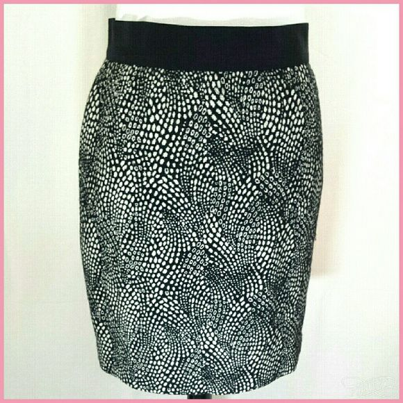Sale!! Ann Taylor Petite pencil skirt Gorgeous Ann Taylor petites skirt size 0P. Wool feel acrylic and polyester weave fabric fully lined. 27 inch waist 34 inch hip 19 inches long. Grosgrain ribbon waist back zip. Shown with Peter Nygard jacket also available in closet, bundle and save! Ann Taylor Skirts Pencil