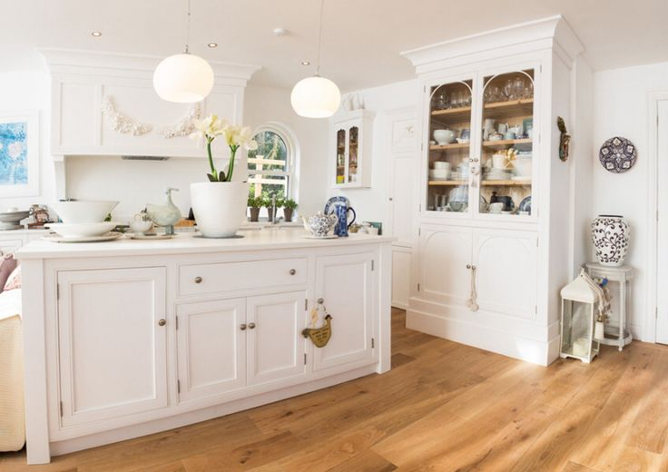 bespoke inframe kitchen and island hand painted in a white with a white quartz worktop