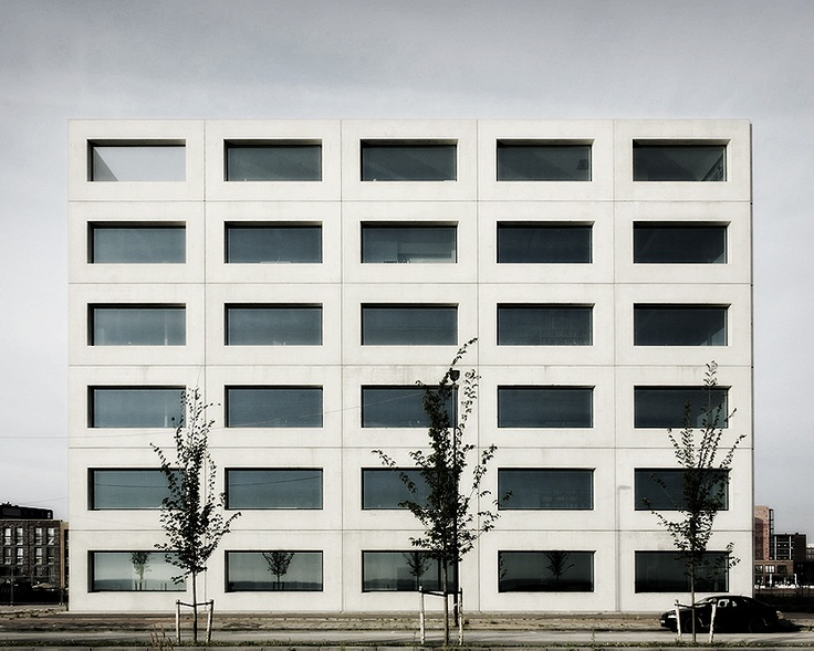 Office building on IJburg, Amsterdam by Claus en Kaan Architecten. I like the stark minimalism of this building. One unit, two materials, repeated. The large seize of the glass panels adds a feeling of generosity to the building. Photo by Primabeeld, edit by NOMAA|marco jongmans.