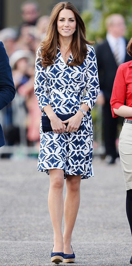 The Duchess stepped out in an ikat batik-print navy-and-white Diane von Furstenberg wrap dress, styling her playful look with a navy clutch and Stuart Weitzman cork wedges.