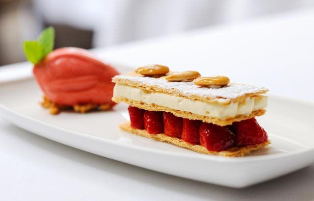 This strawberry mille feuille recipe from Stephen Crane is elegant enough to serve to a princess. Mille feuille does require a bit of effort, but it does taste is as good as it looks, so this summer dessert is worth the preparation. The custard-filled pastry is served with an English strawberry sorbet. You can find more sweet treats in our dessert recipes collection